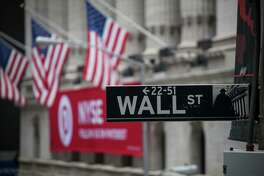 A Wall Street sign is displayed in front of the New York Stock Exchange in New York on Feb. 9, 2018.