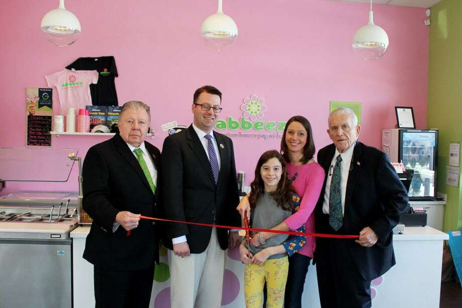 Abbeez Premium Frozen Yogurt Bar held a grand reopening March 15 at 11 N. Main St., East Hampton. Middlesex County Chamber of Commerce President Larry McHugh joined owner Jessica Stewart and her family, along with Town Manager Michael Maniscalco and Chamber Vice Chairman Jay Polke at the event. Photo: Contributed Photo