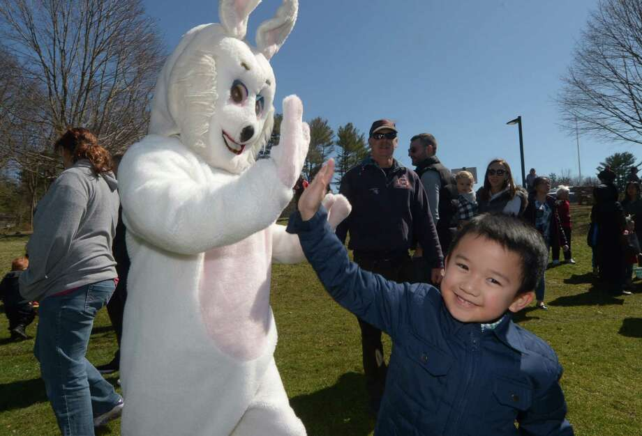 Rocco Valencia, 4, attends The Greens Farms Volunteer Fire Company 67th Annual Easter Egg Hunt Saturday, March 31, 2018, on the grounds of Long Lots School in Westport, Conn. Photo: Erik Trautmann, Hearst Connecticut Media / Norwalk Hour