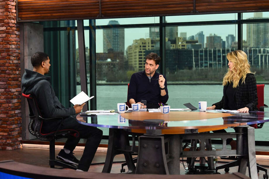 Jalen Rose, left, Mike Greenberg and Michelle Beadle on the set of