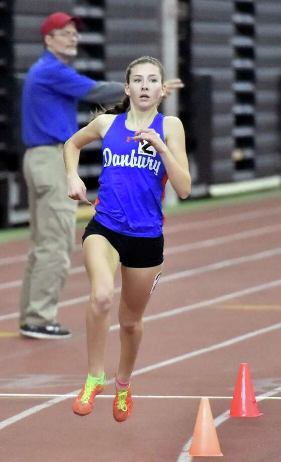 New Haven,  Connecticut - Saturday, February 10, 2018: Girls 1600 Meter winner  Lauren Moore of Danbury H.S. runs her second lap enroute to a victory in the 2018 State Class LL Girls and Boys Indoor Track and Field Championship at the Floyd Little Athletic Center in New Haven. Photo: Peter Hvizdak / Hearst Connecticut Media / New Haven Register
