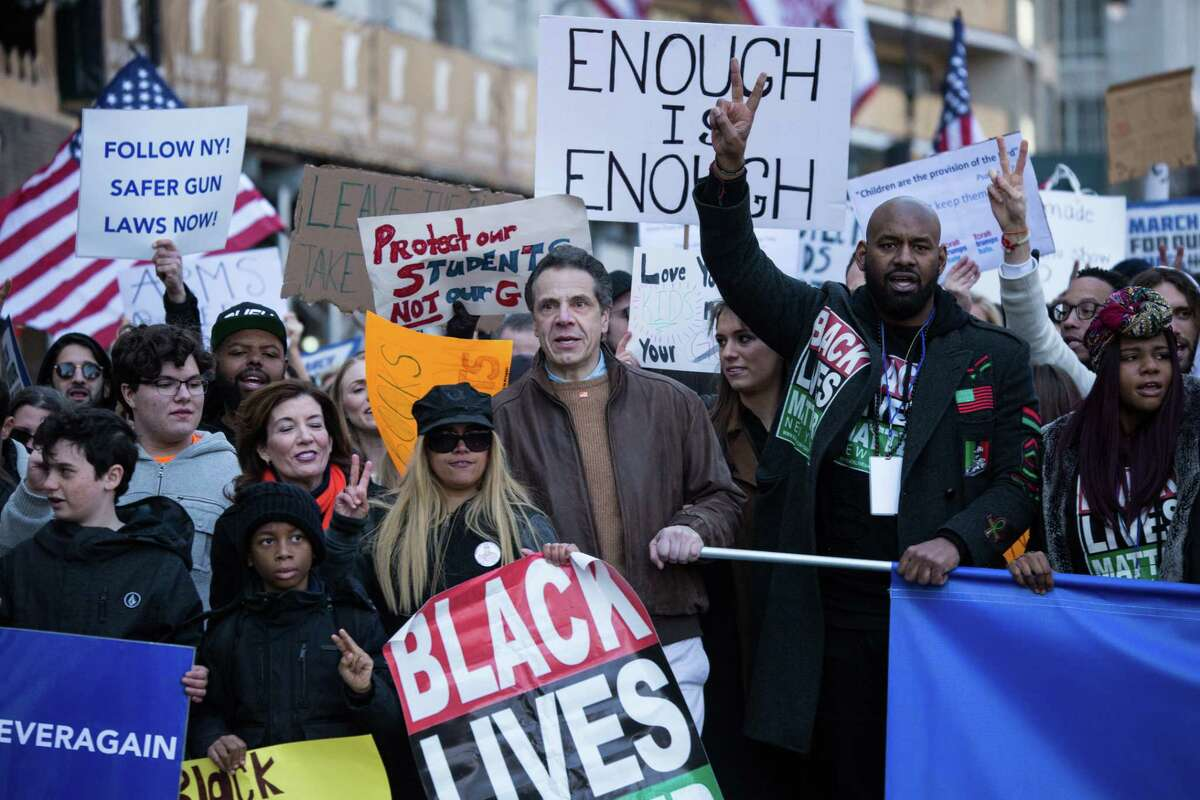 Andrew Cuomo, governor of New York, center, gathers with demonstrators near Central Park during the March For Our Lives in New York, U.S., on March 24, 2018. Thousands of high school students and other gun-control advocates gathered in Washington and across the U.S. Saturday to demand tougher firearms restrictions from an older generation that's delivered little change after years of mass shootings. Photographer: Jeenah Moon/Bloomberg