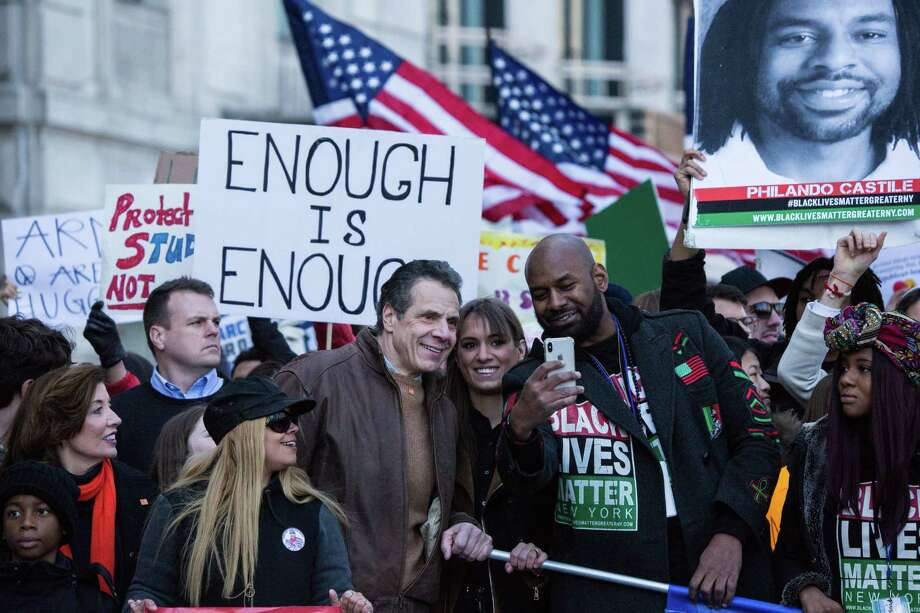 Andrew Cuomo, governor of New York, center, takes a selfie photograph with demonstrators near Central Park during the March For Our Lives in New York, U.S., on March 24, 2018. Thousands of high school students and other gun-control advocates gathered in Washington and across the U.S. Saturday to demand tougher firearms restrictions from an older generation that's delivered little change after years of mass shootings. Photographer: Jeenah Moon/Bloomberg Photo: Jeenah Moon, Bloomberg News Service / © 2018 Bloomberg Finance LP