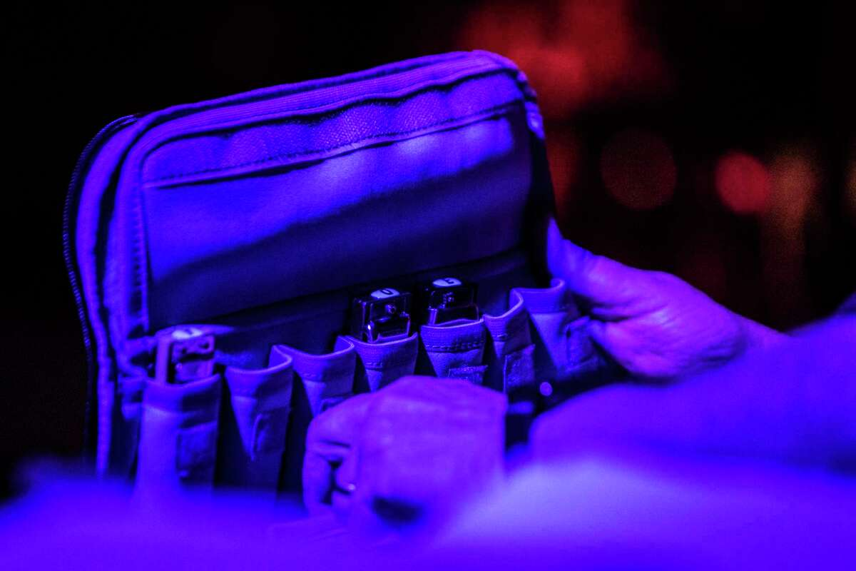 Houston immunologist Jim Allison opens a case full of harmonicas at a benefit concert by the Checkmates, his MD Anderson Cancer Center band of doctors and scientists, at the Firehouse Saloon Saturday, March 31, 2018, in Houston.