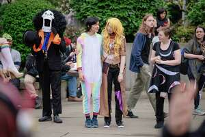 Cosplayers mingle outside the Washington State Convention Center on the third and final day of Sakura-Con, Seattle's annual anime convention, on Sunday, April 1, 2018.
