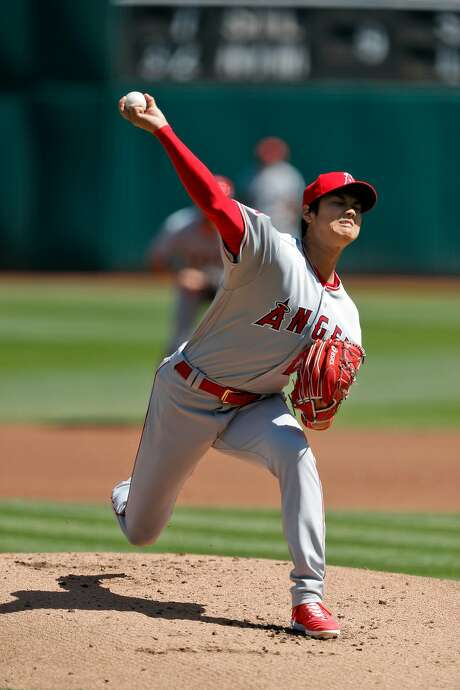 Shohei Ohtani (17) pitches in the first inning as the Oakland Athletics played the Los Angeles Angels of Anaheim at the Oakland Coliseum in Oakland, Calif., on Sunday, April 1, 2018. Photo: Carlos Avila Gonzalez / The Chronicle