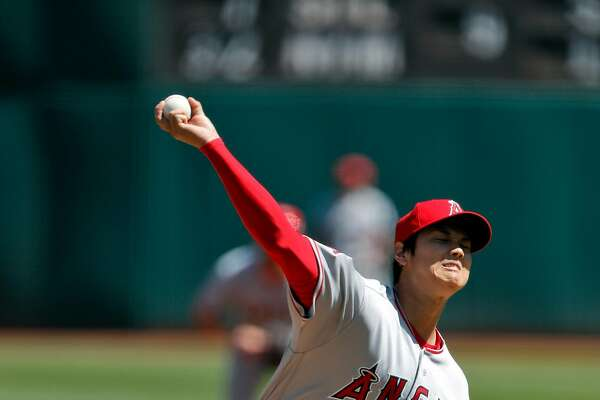 Shohei Ohtani (17) pitches in the first inning as the Oakland Athletics played the Los Angeles Angels of Anaheim at the Oakland Coliseum in Oakland, Calif., on Sunday, April 1, 2018.