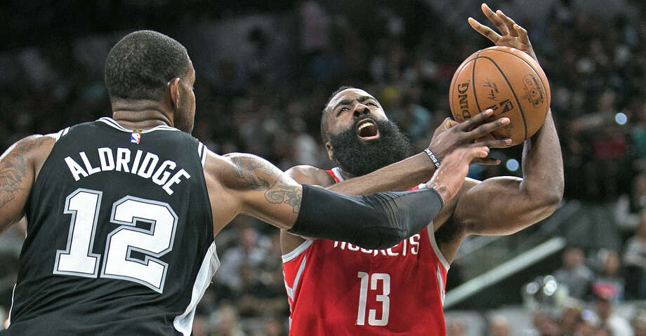 SAN ANTONIO,TX - APRIL 1 :  James Harden #13 of the Houston Rockets has his shot blocked by LaMarcus Aldridge #12 of the San Antonio Spurs at AT&T Center on April 1 , 2018  in San Antonio, Texas.  NOTE TO USER: User expressly acknowledges and agrees that , by downloading and or using this photograph, User is consenting to the terms and conditions of the Getty Images License Agreement. (Photo by Ronald Cortes/Getty Images) Photo: Ronald Cortes/Getty Images