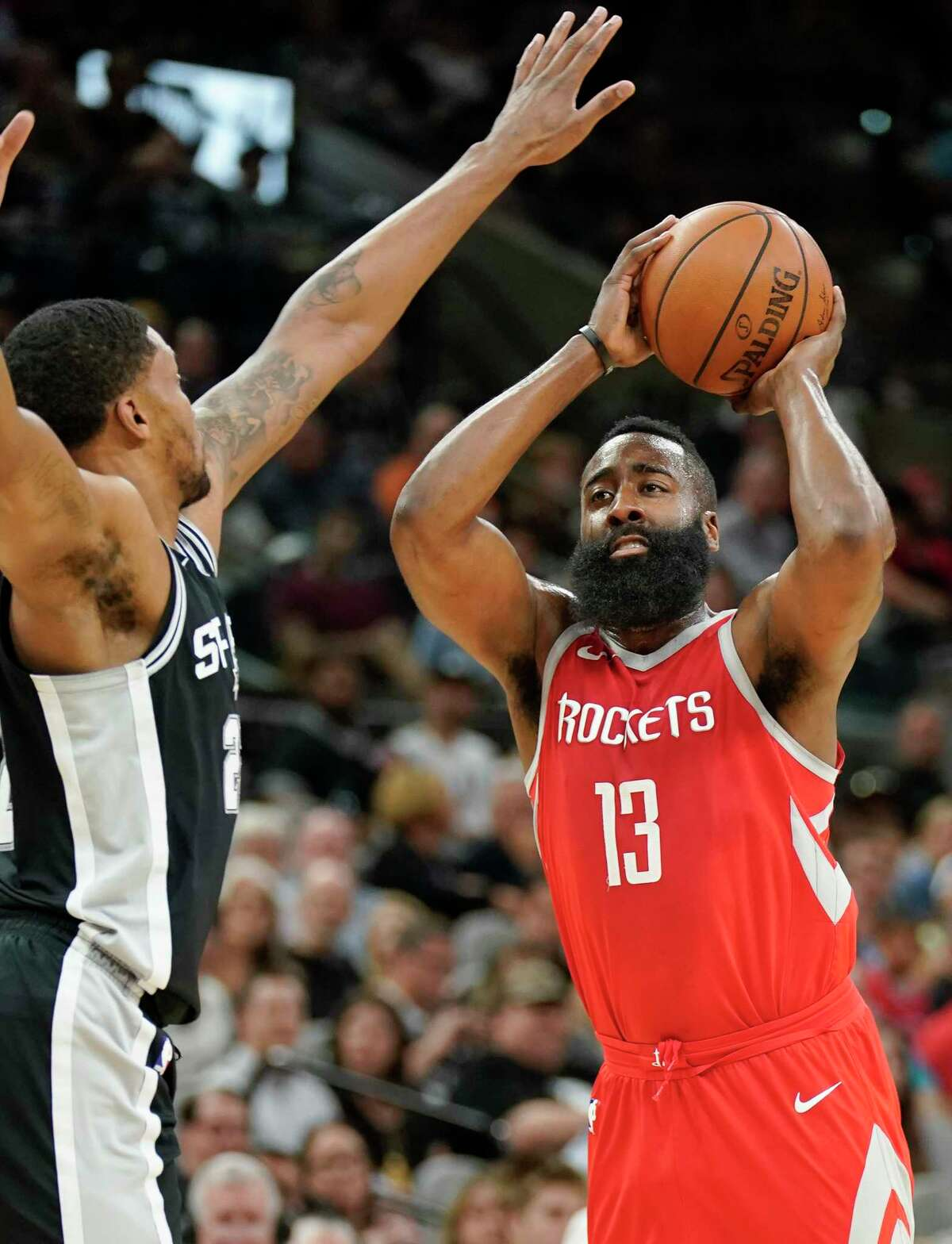 Houston Rockets' James Harden (13) attempts to shoot against San Antonio Spurs' Rudy Gay during the first half of an NBA basketball game, Sunday, April 1, 2018, in San Antonio. (AP Photo/Darren Abate)