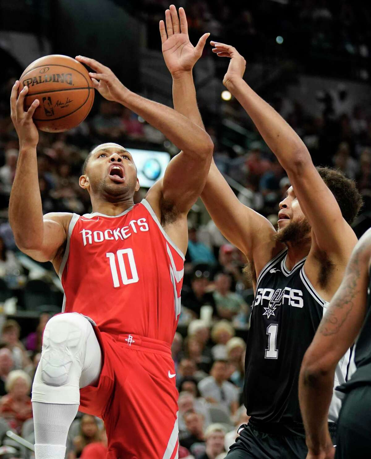 Houston Rockets' Eric Gordon (10) shoots against San Antonio Spurs' Kyle Anderson during the first half of an NBA basketball game, Sunday, April 1, 2018, in San Antonio. (AP Photo/Darren Abate)