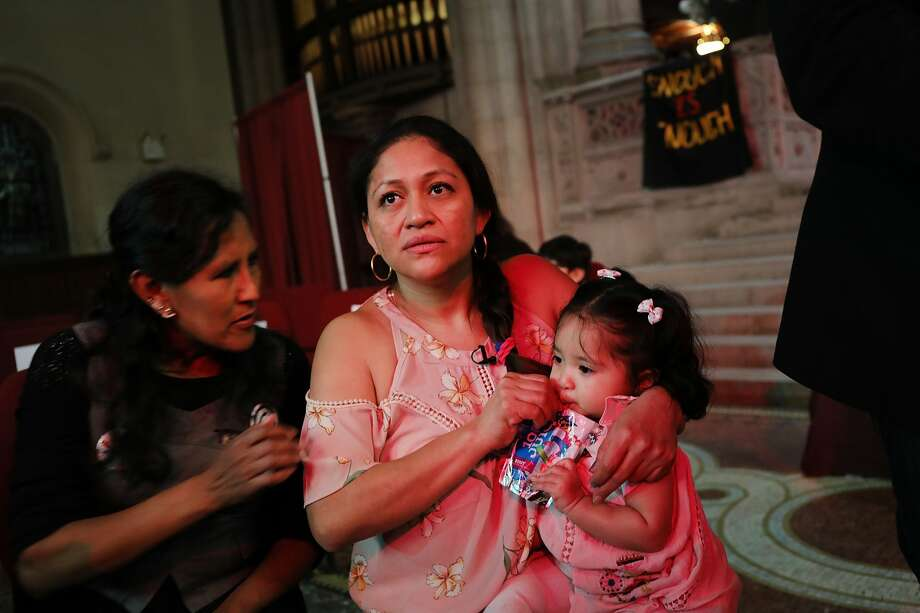 Aura Hernandez, a 37-year-old woman from Guatemala taking sanctuary in a Manhattan church, holds her 15-month-old daughter during a vigil and procession in coordination with the New Sanctuary Coalition on March 29, 2018 in New York City. The immigrant mother of two is desperately trying to avoid being deported back to Guatemala by immigration agents. As the Trump administration continues to go after immigrants to deport, there are currently 42 immigrants in 25 states seeking sanctuary in houses of worship. Photo: Spencer Platt/Getty Images