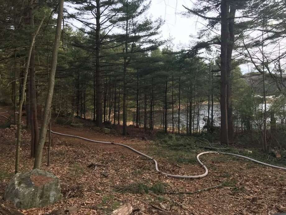 Firefighters were on Haddad Road in Seymour on Sunday, April1 2018, battling another large brushfire roughly 24 hours after fighting another such fire. Photo: Contributed / Courtesy Of The Seymour Fire Department Facebook Page