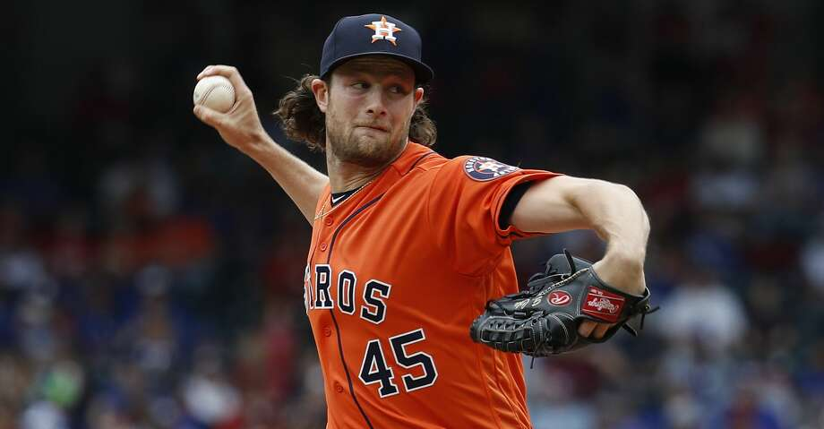 Houston Astros starting pitcher Gerrit Cole (45) pitches in the first inning of an MLB baseball game at Globe Life Park, Sunday, April 1, 2018, in Arlington.   ( Karen Warren / Houston Chronicle ) Photo: Karen Warren/Houston Chronicle