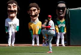 The Oakland Athletics Big Heads watch Shohei Ohtani (17) warm up before the Oakland Athletics played the Los Angeles Angels of Anaheim at the Oakland Coliseum in Oakland, Calif., on Sunday, April 1, 2018.