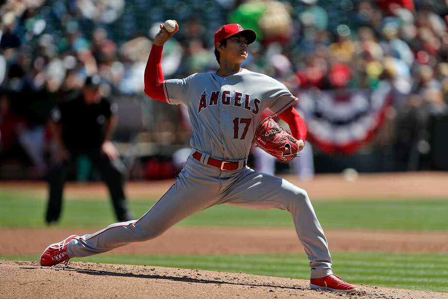 Shohei Ohtani (17) pitches in the second inning as the Oakland Athletics played the Los Angeles Angels of Anaheim at the Oakland Coliseum in Oakland, Calif., on Sunday, April 1, 2018. Photo: Carlos Avila Gonzalez / The Chronicle