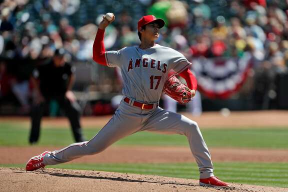 Shohei Ohtani (17) pitches in the second inning as the Oakland Athletics played the Los Angeles Angels of Anaheim at the Oakland Coliseum in Oakland, Calif., on Sunday, April 1, 2018.