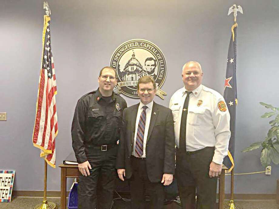 New Springfield Fire Chief Al Reyne, left, with Springfield Mayor Jim Langfelder and outgoing Fire Chief Barry Helmerichs. Photo: For The Telegraph