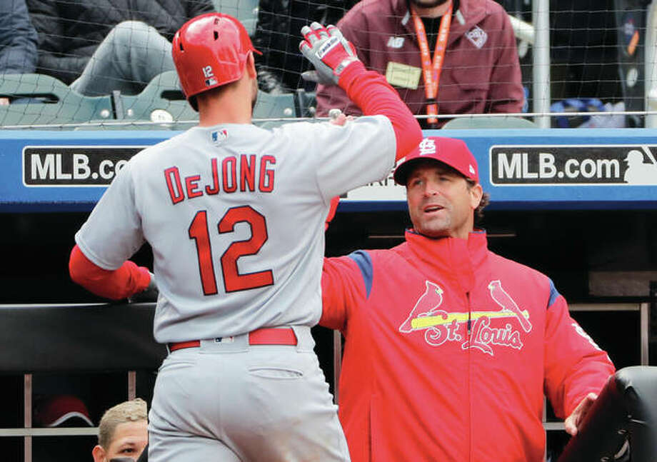 Cardinals manager Mike Matheny (right) greets shortstop Paul DeJong after DeJong hit his second home run of the day during the eighth inning against the Mets on Sunday in New York. Photo: Associated Press