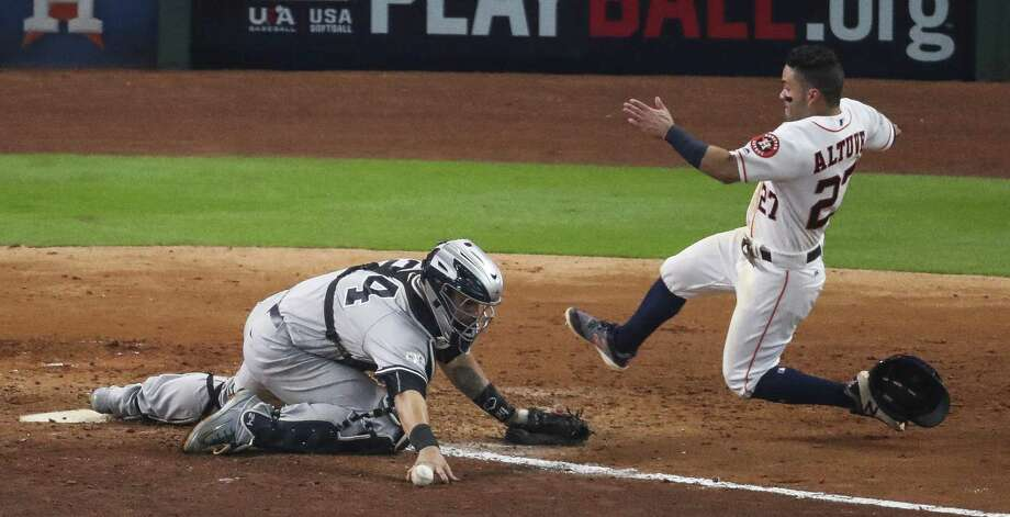 Houston's José Altuve made a seemingly impossible dash to beat the ball to home plate, scoring the winning run in Game 2 of the 2017 World Series. Photo: Michael Ciaglo, Houston Chronicle / Houston Chronicle / Michael Ciaglo