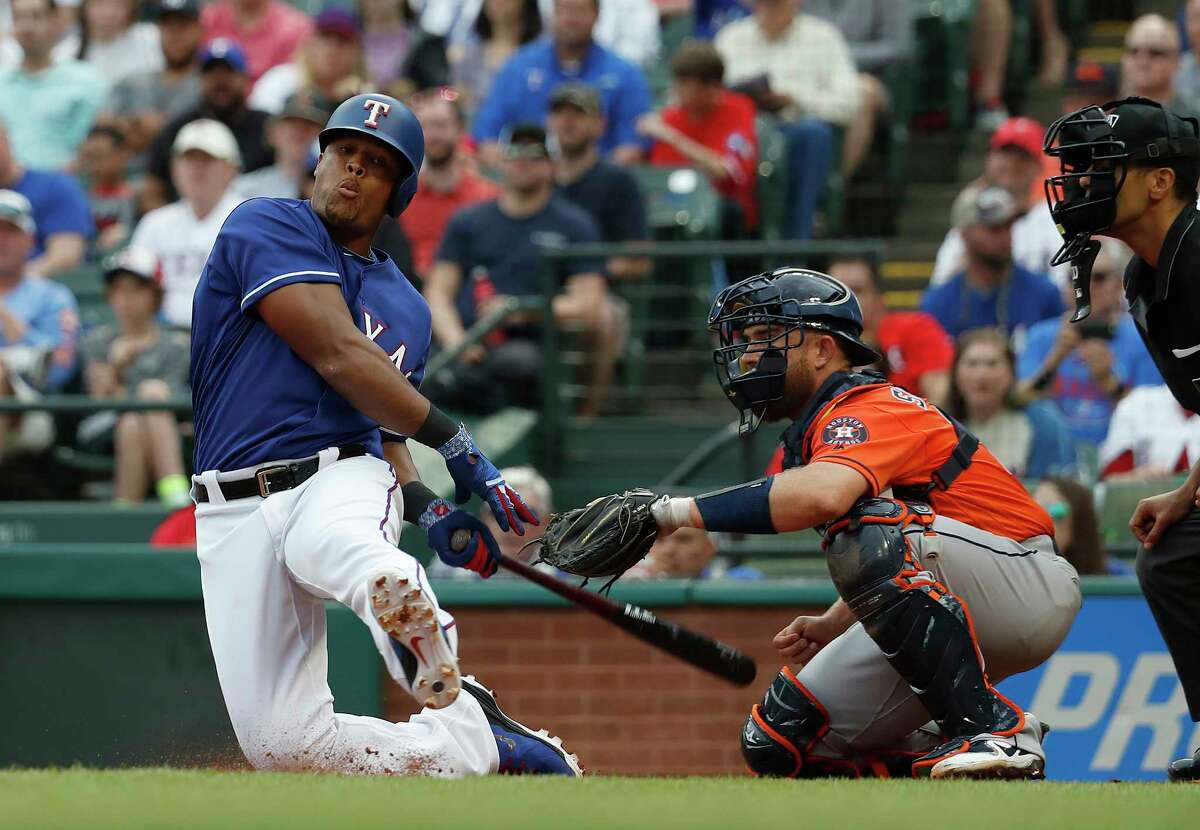 Texas Rangers Adrian Beltre (29) falls to his knees swinging at a strike from Houston Astros starting pitcher Gerrit Cole (45) in the third inning of an MLB baseball game at Globe Life Park, Sunday, April 1, 2018, in Arlington.