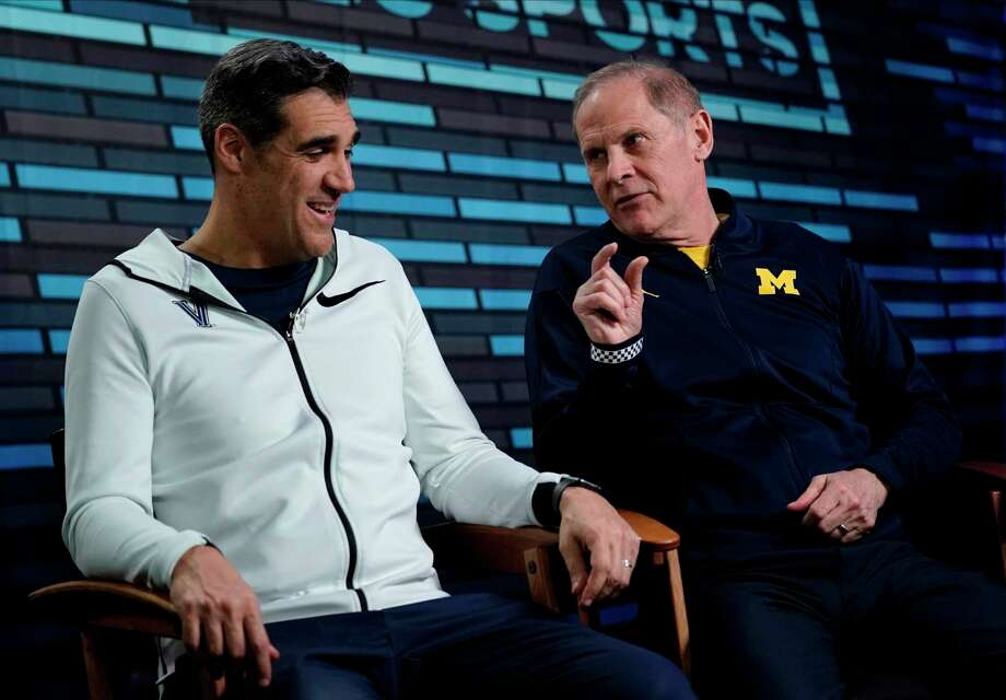 "Villanova head coach Jay Wright, left, and Michigan head coach John Beilein answer questions during an interview for CBS Sports Network's ""We Need to Talk"" show before the championship game of the Final Four NCAA college basketball tournament, Sunday, April 1, 2018, in San Antonio. (AP Photo/David J. Phillip) Photo: David J. Phillip, STF / AP"
