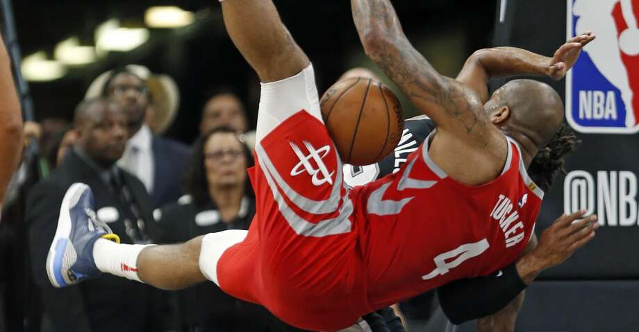 SAN ANTONIO,TX - APRIL 1 :  PJ Tucker #4 of the Houston Rockets takes a hard fall after battling Patty Mills #8 of the San Antonio Spurs for the ball at AT&T Center on April 1 , 2018  in San Antonio, Texas.  NOTE TO USER: User expressly acknowledges and agrees that , by downloading and or using this photograph, User is consenting to the terms and conditions of the Getty Images License Agreement. (Photo by Ronald Cortes/Getty Images) Photo: Ronald Cortes/Getty Images
