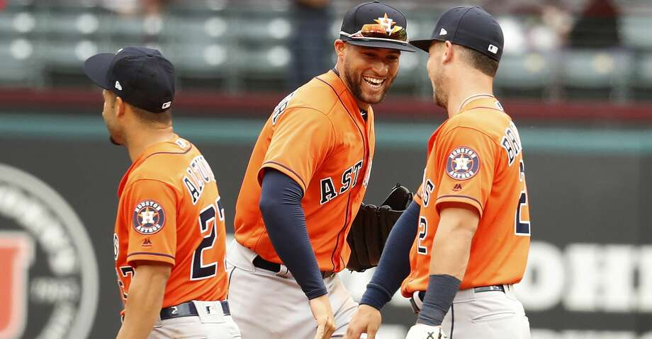 Houston Astros George Springer (4),Jose Altuve and Alex Bregman (2) celebrate their 8-2 win over the Texas Rangers after an MLB baseball game at Globe Life Park, Sunday, April 1, 2018, in Arlington.   ( Karen Warren / Houston Chronicle ) Photo: Karen Warren/Houston Chronicle