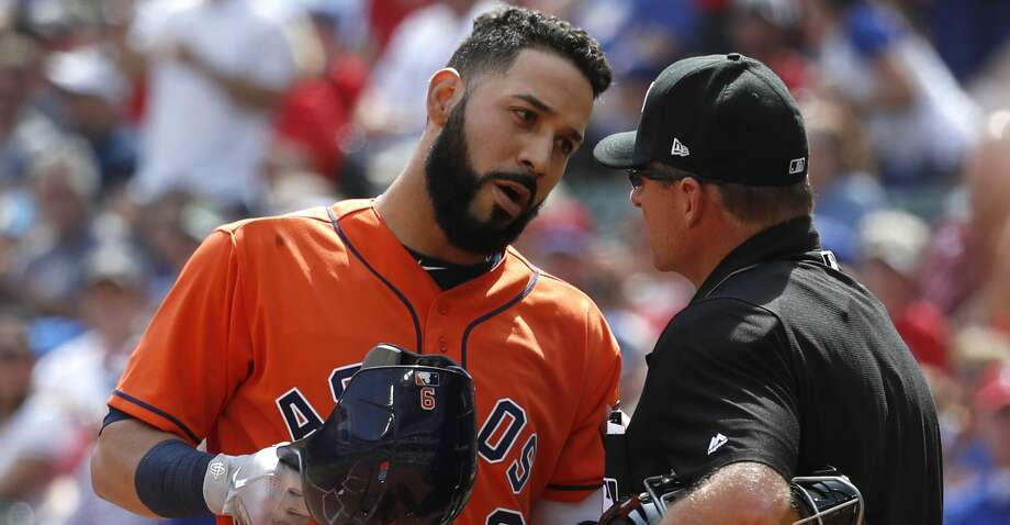 Houston Astros left fielder Marwin Gonzalez (9) chats with home plate umpire umpire Ed Hickox after striking out in the first inning of an MLB baseball game at Globe Life Park, Saturday, March 31, 2018, in Arlington.   ( Karen Warren / Houston Chronicle ) Photo: Karen Warren/Houston Chronicle