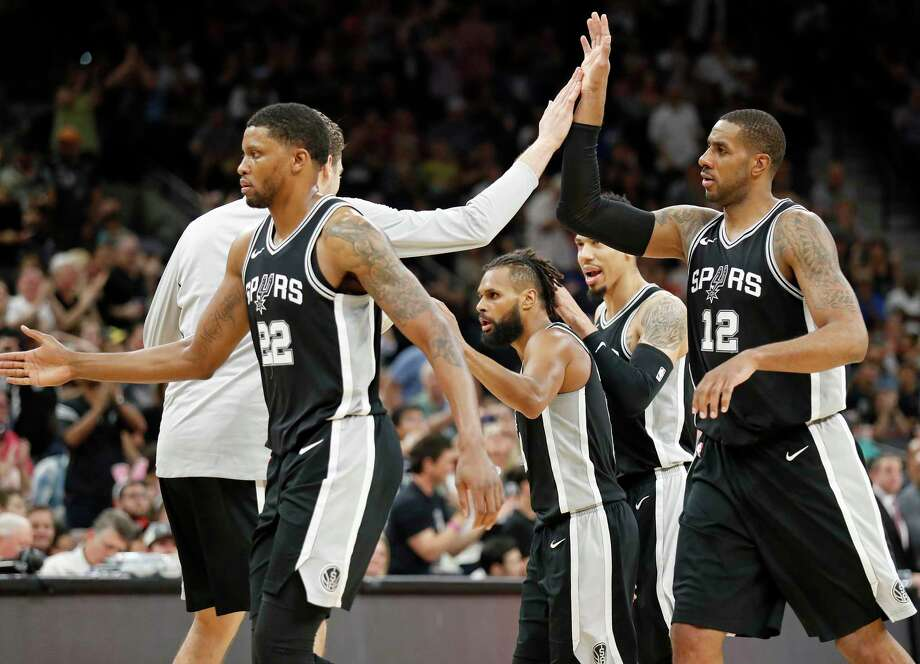 San Antonio SpursÕ Patty Mills (center) is congratulated by teammates Rudy Gay (from left), Pau Gasol, Danny Green and LaMarcus Aldridge after scoring a 3-pointer during second half action against the Houston Rockets Sunday April 1, 2018 at the AT&T Center. The Spurs won 100-83. Photo: Edward A. Ornelas, San Antonio Express-News / © 2018 San Antonio Express-News