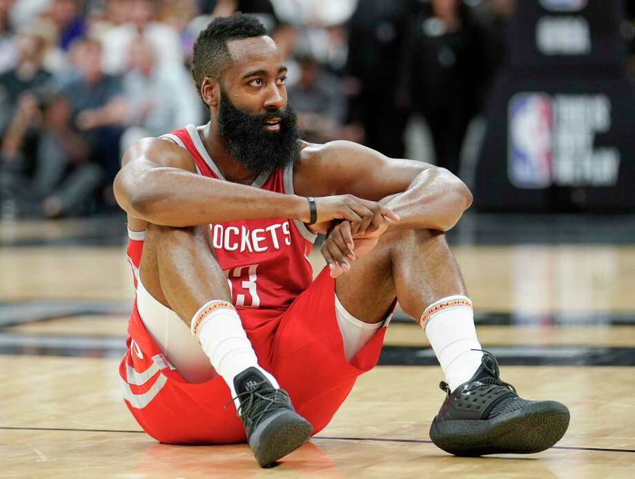 Houston Rockets guard James Harden sits on the court during a timeout in the second half of the team's NBA basketball game against the San Antonio Spurs, Sunday, April 1, 2018, in San Antonio. San Antonio won 100-83. (AP Photo/Darren Abate) Photo: Darren Abate, FRE / FR115 AP