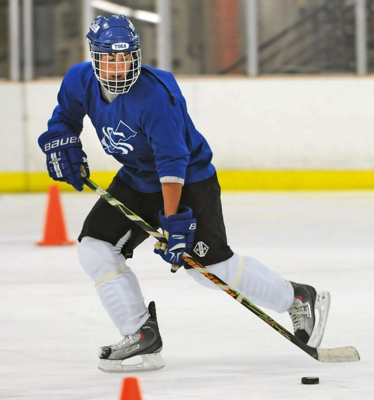 Saratoga Springs hockey player Cody Nizolek runs a drill during practice at the Streaks' home rink. (Lori Van Buren / Times Union)