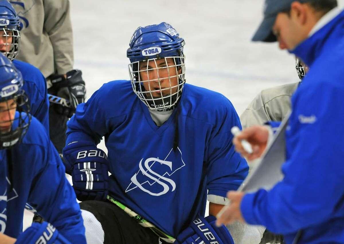 Saratoga Springs hockey player Cody Nizolek listens to his coach explain the next dril. (Lori Van Buren / Times Union)