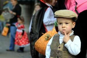 Maxwell Vogel, 23-months-old, of Saratoga Springs, dresses as the golfer Bobby Jones during the eighth annual Saratoga Fall Festival on Saturday. The festival continues Sunday from 11 a.m. to 4 p.m. (Cindy Schultz / Times Union)