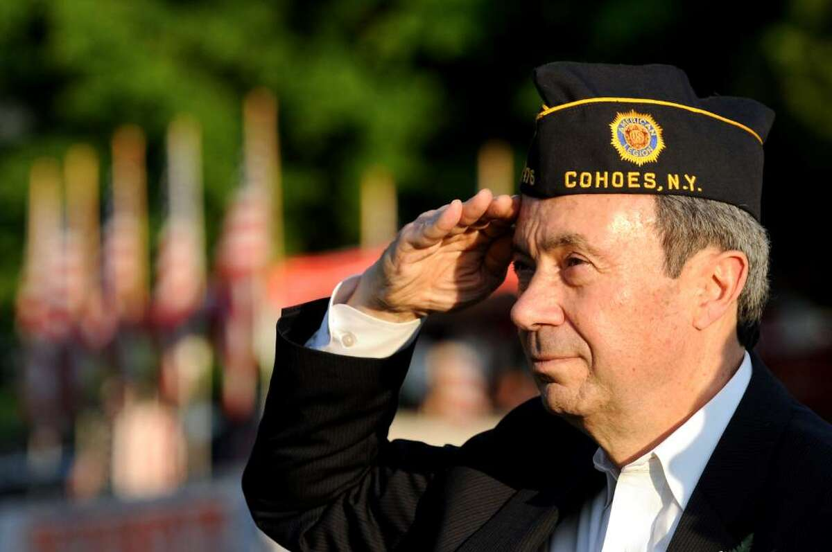 The Capital Region is already celebrating the long Memorial Day holiday as Assemblyman Ron Canestrari serves as the grand marshal of the Cohoes Memorial Day parade, which steps off Thursday in the city. He is saluting during the National Anthem. (Cindy Schultz / Times Union)