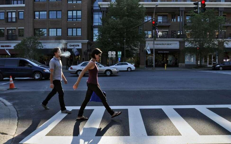Joshua Carter and Sarah Barthel of the band Phantogram, walk along Brioadway in Saratoga Springs. ( Philip Kamrass / Times Union)