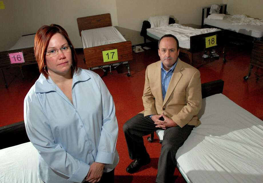 Program director Alyssa Lamson-Reiners, left, and executive director Keith Stack, right, in the detox center on Wednesday, Oct. 14, 2009, at the Addictions Care Center of Albany Inc. in Albany, N.Y. (Cindy Schultz / Times Union) Photo: CINDY SCHULTZ
