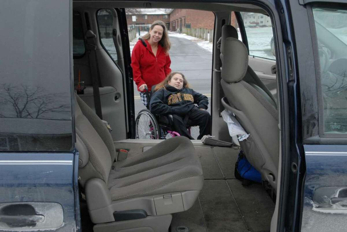 Cindy Macey and her daughter Tammy Macey outside their van at their home in Troy. (Paul Buckowski / Times Union)