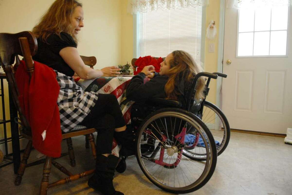 Cindy Macey and her daughter Tammy Macey spend some time together at their home in Troy. (Paul Buckowski / Times Union)