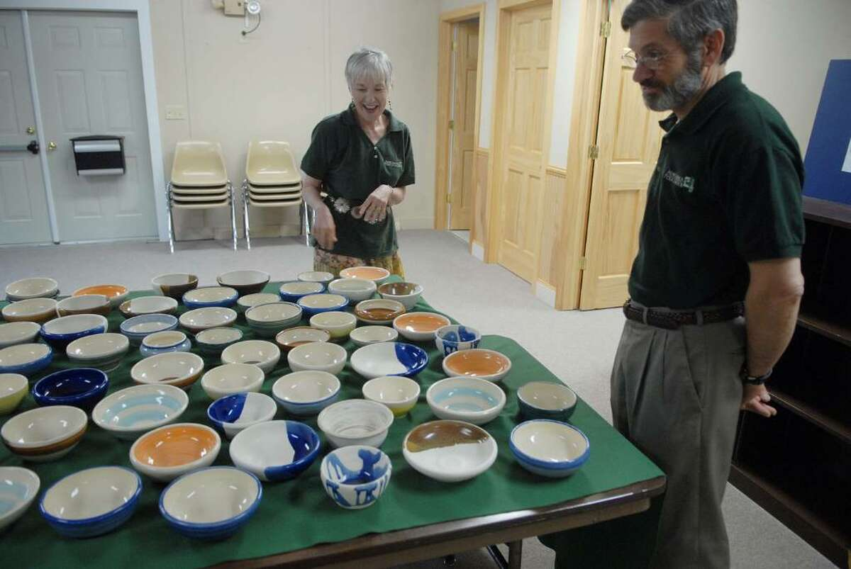 Executive Director Sandy Sherman, left, and Chairman and founder Jim Mandle, right, look over some bowls made by Jim's wife, during a tour of the Adirondack Folk School in Lake Luzerne, on Tuesday, May 4, 2010. The bowls will be sold off during the Bountiful Bowl Benefit with the proceeds being shared by the school and the Luzerne Food Pantry. The Adirondack Folk School will be dedicated to teaching the arts, crafts and culture of the Adirondack region. (Paul Buckowski / Times Union)
