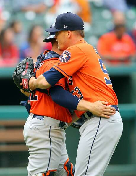 ARLINGTON, TX - APRIL 01: Max Stassi #12 of the Houston Astros congratulates Ken Giles #53 for closing out the game for the win against the Texas Rangers at Globe Life Park in Arlington on April 1, 2018 in Arlington, Texas. (Photo by Rick Yeatts/Getty Images) Photo: Rick Yeatts/Getty Images