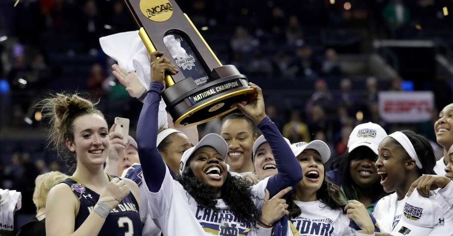 Notre Dame's Arike Ogunbowale holds the trophy after defeating Mississippi State in the final of the women's NCAA Final Four college basketball tournament, Sunday, April 1, 2018, in Columbus, Ohio. Notre Dame won 61-58. (AP Photo/Tony Dejak) Photo: Tony Dejak/Associated Press