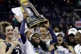 Notre Dame's Arike Ogunbowale holds the trophy after defeating Mississippi State in the final of the women's NCAA Final Four college basketball tournament, Sunday, April 1, 2018, in Columbus, Ohio. Notre Dame won 61-58. (AP Photo/Tony Dejak)