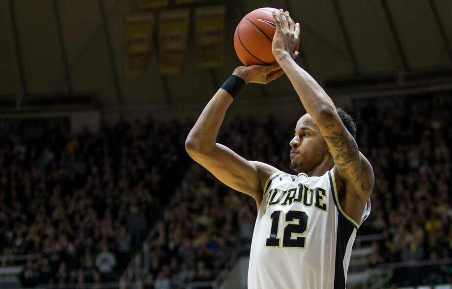 Purdue's Vince Edwards (12) shoots a 3-pointer during the second half of Purdue's 91-80 win against Wisconsin in an NCAA college basketball game Sunday, March 6, 2016, in West Lafayette, Ind. Photo: Robert Franklin, AP / FR17139 AP