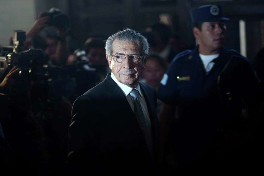 FILE - In this Jan. 26, 2012, file photo, Guatemala's former dictator Efrain Rios Montt (1982-1983), who faces genocide charges, returns from a break in court in Guatemala City. According to his lawyer, Rios Montt died Sunday, April 1, 2018, in Guatemala City of a heart attack.(AP Photo/Rodrigo Abd, File) Photo: Rodrigo Abd / Copyright 2018 The Associated Press. All rights reserved.