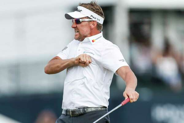 Ian Poulter celebrates after hitting a 20-foot birdie putt on the 18th hole to force a playoff with Beau Hossler during the Championship Round of the Houston Open Sunday, April 1, 2018 in Humble. Poulter won the Houston open after the first hole of the playoff.