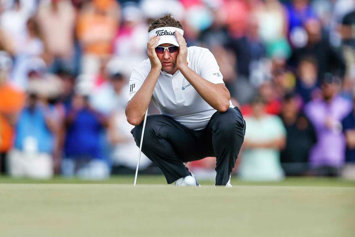 Ian Poulter lines up a putt on the 18th hole that will force a playoff with Beau Hossler during the Championship Round of the Houston Open Sunday, April 1, 2018 in Humble. Poulter won the Houston open after the first hole of the playoff.