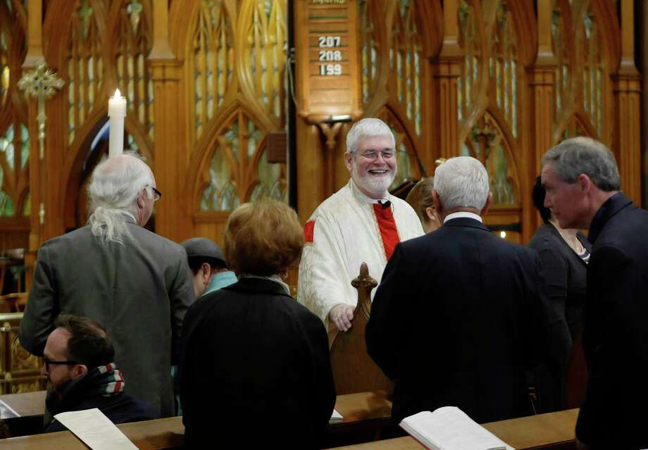 The Rev. Michael Gorchov, Rector, visits with parishioners during Easter service at St. Paul's Episcopal Church on Sunday, April 1, 2018, in Troy, N.Y.  (Paul Buckowski/Times Union) Photo: PAUL BUCKOWSKI / (Paul Buckowski/Times Union)