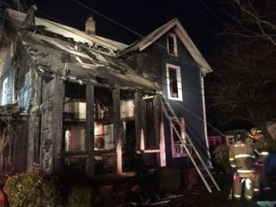 An severely damaged a single family house on Naugatuck Avenue in Milford the evening of Sunday, April 1, 2018. Photo: Contributed / Milford Fire Department