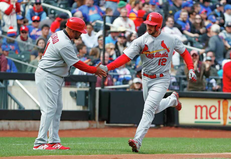 St. Louis Cardinals third base coach Jose Oquendo, left, congratulates the Cardinals' Paul DeJong (12) who hit a solo home run during the second inning of a baseball game against the New York Mets, Sunday, April 1, 2018, in New York. (AP Photo/Kathy Willens) Photo: Kathy Willens / Associated Press