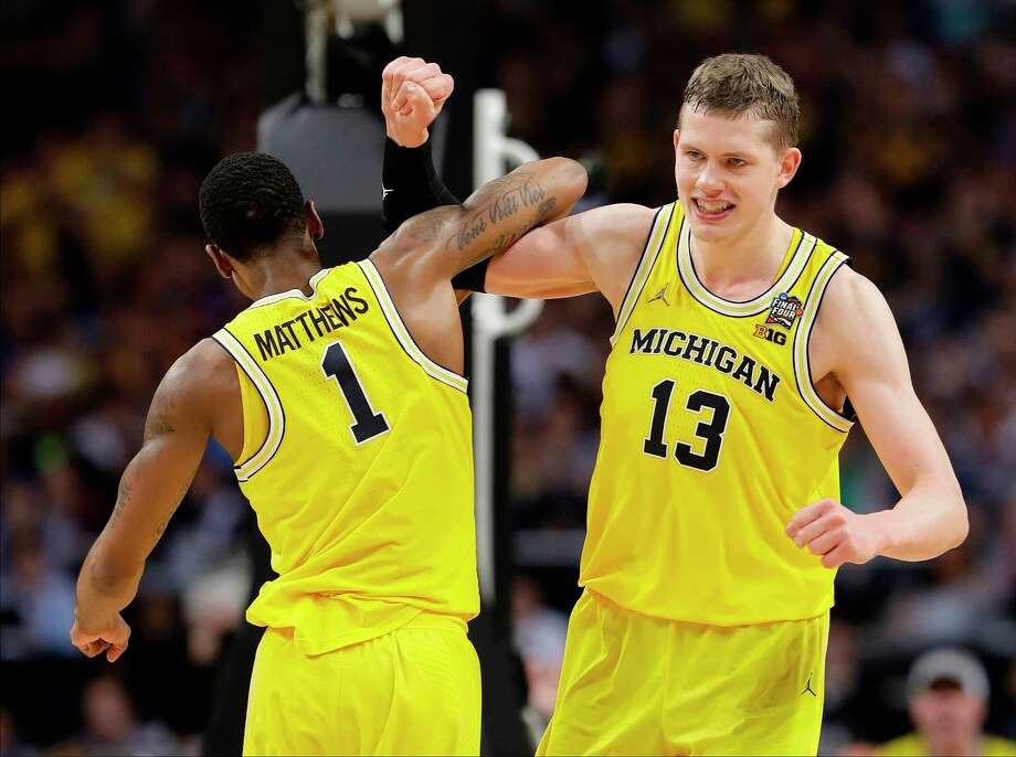 Michigan's Moritz Wagner (13) celebrates with Charles Matthews (1) during the second half in the semifinals of the Final Four NCAA college basketball tournament against Loyola-Chicago, Saturday, March 31, 2018, in San Antonio. (AP Photo/Eric Gay) Photo: Eric Gay / Copyright 2018 The Associated Press. All rights reserved.